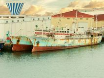 Two old scrapped cargo ships in the harbor of Las Palmas, Gran Canaria, Canary islands Stock Image