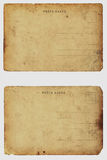 Two old shabby blank postcards. Two old shabby blank postcards (scan). On white Royalty Free Stock Photography