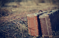 Two old shabby suitcases Stock Photos