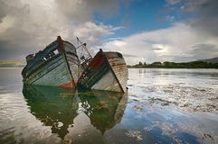 Two old shipwrecks. At the coast of Scotland (Great Britain Stock Photography