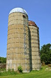 Two old silos  on a farm Stock Image