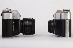 Two old SLR cameras Stock Images