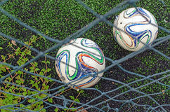 Two old soccer ball on grass Stock Photography