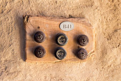 Two old sockets and four switches on а wooden plate. Stock Photos