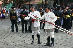 Two old soldiers of Yogyakarta palace prepare weapons