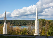 Two old space rocket on a background of the river. Soviet missiles on the banks of the river Stock Photo