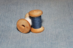 Two old spools of thread and needles Stock Image