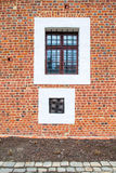 Two old square windows, one with steel grating Royalty Free Stock Photos