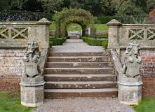 Two old stone lion statues with shields stand at the bottom of a small flight of steps royalty free stock photography