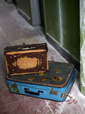 Two old suitcases. On a dirty floor Stock Images