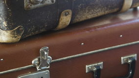 Two old suitcases, lie on the shelf. Close-up. Two old suitcases, lie on the shelf. Close-up HD stock footage