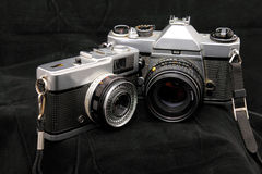 Two Old Timers. Two old film cameras who have severed their owners well Stock Photo
