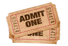 Two old torn and stained admit one movie tickets, white background. Two old torn and stained admit one movie tickets Royalty Free Stock Image