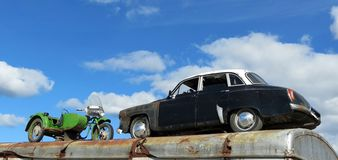 Old car and motorcycle, Lithuania. Two old transports -car and motorcycle stock image