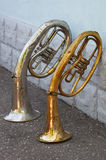 Two old trumpets. Stand at a wall Stock Photography