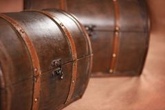 Two old trunks on brown background royalty free stock image