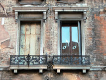 Two Old Venetian Windows Royalty Free Stock Photography