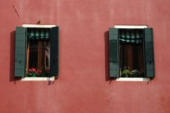 Two Old Venetian windows at sunset,Italy royalty free stock image