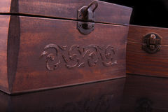 Two old vintage chests patterns on black Royalty Free Stock Photos