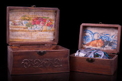 Two old vintage chests patterns on black Royalty Free Stock Images