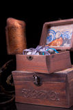 Two old vintage chests patterns with a candle and a candlestick Stock Images