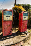 Two old vintage petrol pumps Stock Images