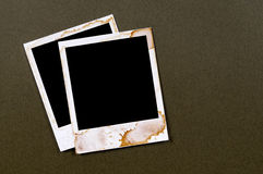 Two old vintage stained polaroid style blank photo print frames Royalty Free Stock Photo