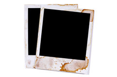Two old vintage stained polaroid style blank photo print frames Stock Images