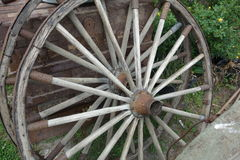 Wheels  from a vintage wagon. These are two antique wagon wheels used on late 19th and 20th centuries wagons, which were essential farming pieces of equipment Royalty Free Stock Images