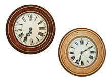Two old wall clocks. Isolated on white background Stock Photography