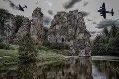 Two old warplanes flying over the Externsteine. Stock Photo