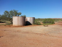 Two old water tanks in Australian outback Stock Photos