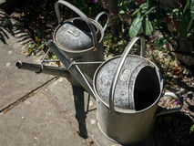 Two old watering cans Royalty Free Stock Images