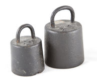 Two old weights royalty free stock photography