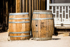 Two old whiskey barrels. In forgotten western town royalty free stock photos