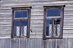 Two old windows on farm wall Stock Photography