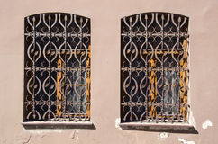 Two old windows with metal gratings Royalty Free Stock Photography