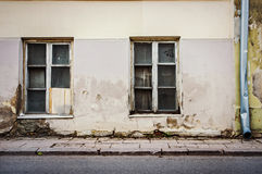 Two old windows on old wall Royalty Free Stock Image