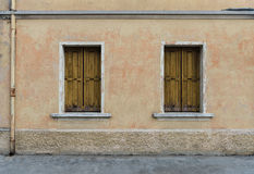 Two old windows with shutters in the old scratched wall, Palmanova Stock Photography