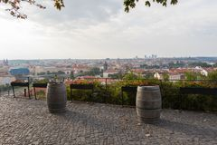 Two old wine barrels and a beautiful view of the Prague skyline royalty free stock photos