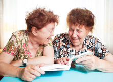 Two Old woman reading book Stock Images