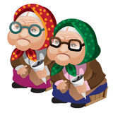Two old women in glasses sitting with seeds Royalty Free Stock Image