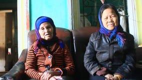 Two old women sing folk songs stock video