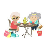 Two old women talking in a cafe after shopping Stock Photos