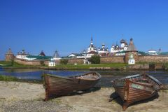 Two old wooden boats on the background of the Solovetsky Monastery. Russia royalty free stock photography