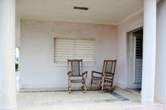 Two old wooden chairs on the porch Royalty Free Stock Photos