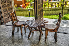 Two old wooden chairs and a table Royalty Free Stock Photos