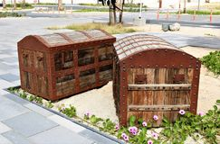 Two old forged chests. Two old wooden chests, standing in a park for decoration Royalty Free Stock Images