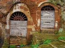 Two Old Wooden Doors in Archway Stock Photos