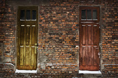 Two old wooden doors in brick wall Stock Image